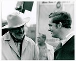 "F08_E15_01 ""The Learning Tree"" cinematographer, Burnett Guffey chats with a young man on location in Bourbon and Linn counties, Kansas by Unknown"