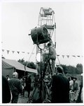 "F09_E06_01 ""The Learning Tree"" crew member sets lights for the carnival scene on location in Bourbon and Linn counties, Kansas by Unknown"