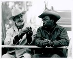 "F09_E07_01 Gordon Parks and cinematographer Burnett Guffey sitting on ferris wheel set from ""The Learning Tree"" on location in Bourbon and Linn counties, Kansas by Unknown"