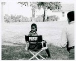 "F09_E09_02 Prissy (Saundra Sharp) sits in her chair on location for ""The Learning Tree"" in Bourbon and Linn counties, Kansas by Unknown"