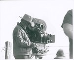"Cameraman stands by his camera on location in Bourbon and Linn counties, Kansas during the filming of ""The Learning Tree"" by Unknown"